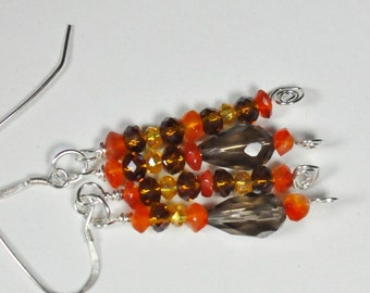 Smokey quartz, orange carnelian, and golden and brown crystals in earrings wrapped in sterling silver