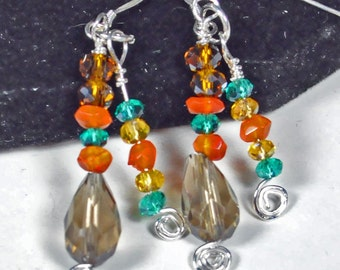 Smokey quartz, carnelian, brown, golden, and turquoise crystal earrings wrapped in sterling silver wire and findings