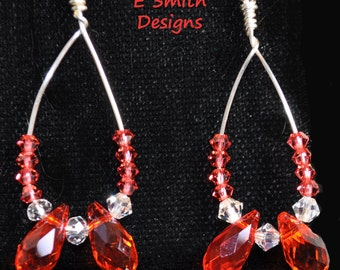 handmade hoops with pinky orange and clear crystals make up these lovely earrings