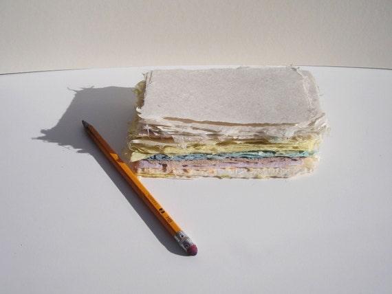 Ten small sheets of handmade paper