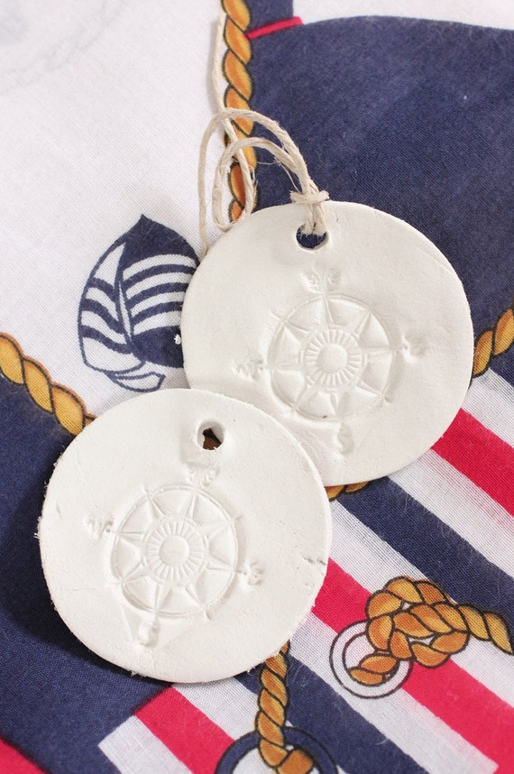 Rustic Clay Compass Tags. Hand stamped Ornaments Set of 2