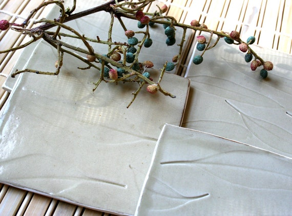 Set of four porcelain coasters with leaf pattern in celadon