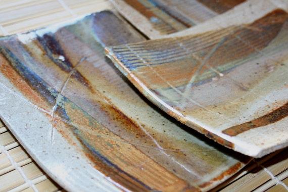 Set of three rustic stoneware plates