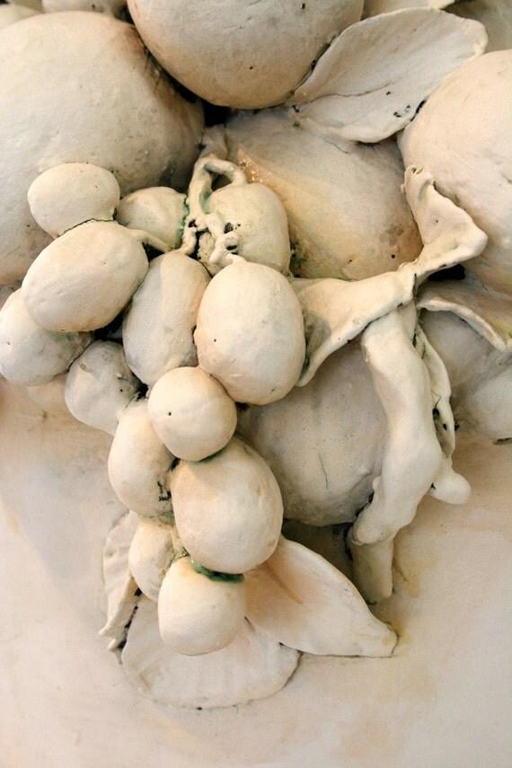 Sculptural ceramic basket of fruit
