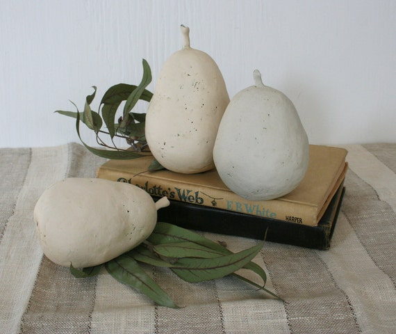 Group of three hand built ceramic pears. Earthy, rustic, pale, hand made, hand painted.