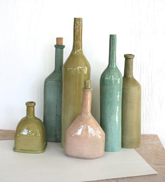 Still life of six bottle forms. Decor, sculpture, hand made, aqua, olive, pink, beach, modern, rustic.