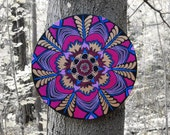 Mandala flower painting in purple, copper, and blue