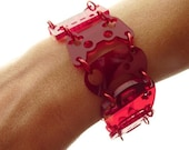 Controller bracelet - red tint with red rings