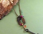 Necklace with antique key and lock plate