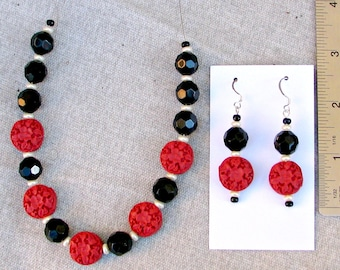 Elegant red and black necklace and earrings set with carved resin beads