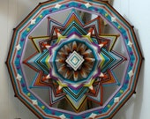 Diamond Sky, a 24 inch, wool yarn, Ojo de Dios, by Jay Mohler