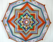 Forest Sun, an 18 inch, 8-sided, ojo de Dios mandala, by custom order
