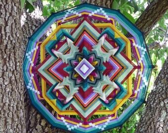 Butterfly World, an 30 inch, 12-sided, Ojo de Dios, by custom order