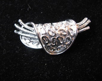 Unusual silver tone embossed  pin brooch  Saddle shape