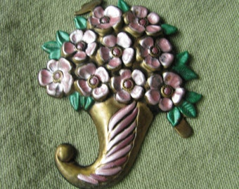 Gold tone vintage pin brooch with pink flower bouquet & green leaves.