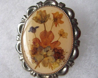 Silver tone oval frame brooch pin with orange autumn flowers