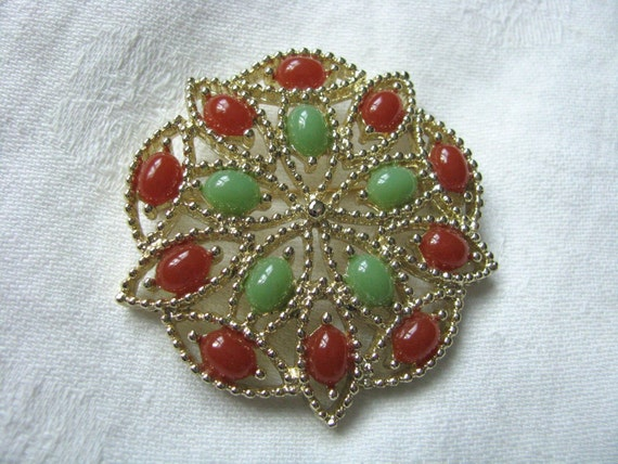 Festive gold tone round red green Acapulco vintage pin brooch bySarah Coventry