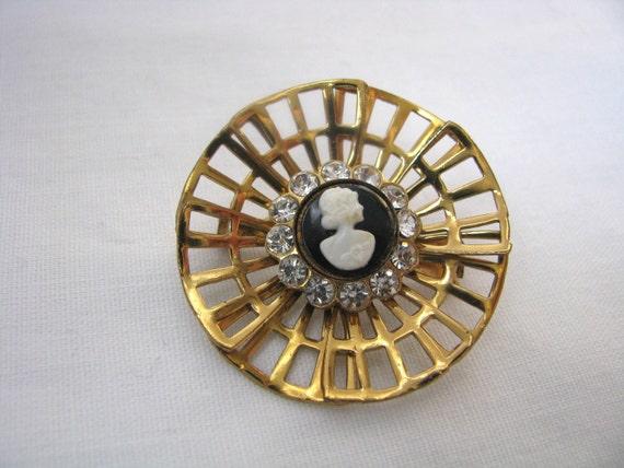 Coro gold tone pin brooch open design w/ cameo and rhinestones