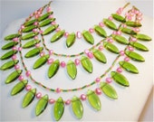 An Art Deco Spring- freshwater pearl necklace, glass