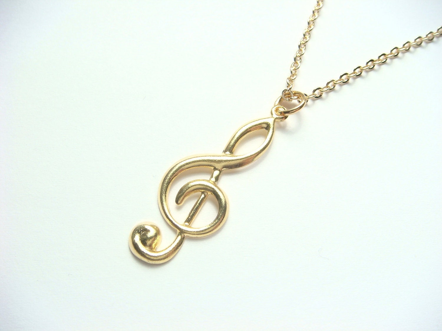 treble clef necklace in gold made with vintage charm