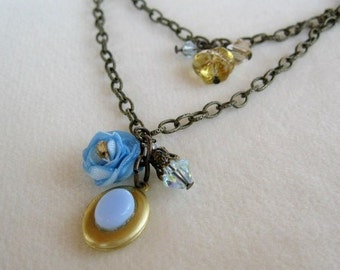 Petite Brass Locket with pale blue fabric flower necklace