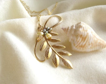 Gold scroll leaf design pendant with pearls on gold fill chain