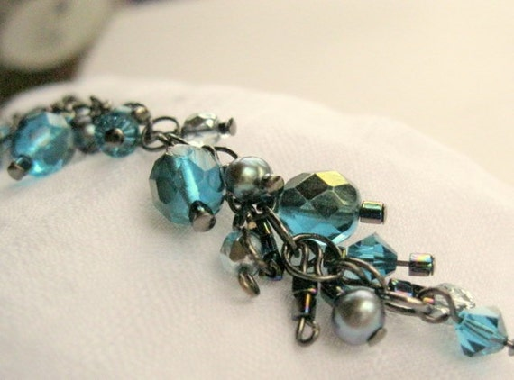 Turquoise crystals and peacock pearls on gun metal bracelet