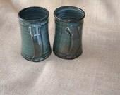 Set of Floating Blue Glazed Mugs