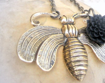 Bumble Bee Necklace with black mum flower. Vintage brass bee pendant with a black flower or a sweet honeycomb bead