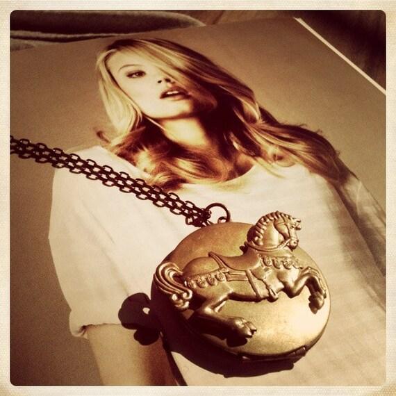 A Vintage Princess Pony locket necklace.