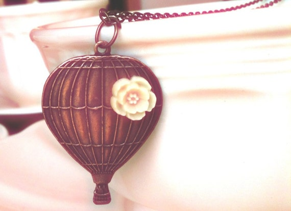 Antiqued Hot Air Balloon with a ivory flower Necklace