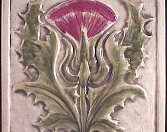 Decorative, relief carved ceramic thistle tile