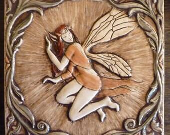 Decoratve relief carved ceramic faerie tile