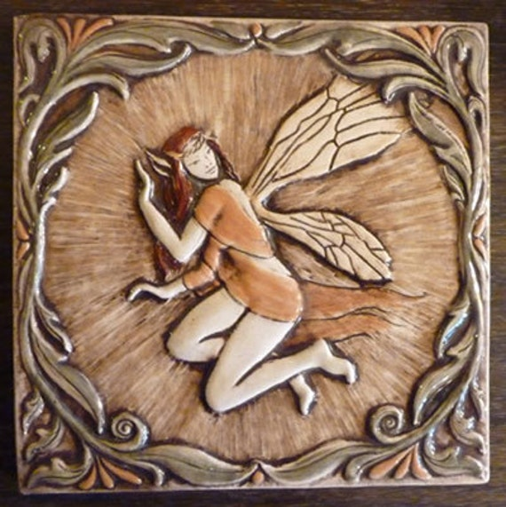 Decoratve relief carved ceramic faerie tile
