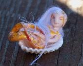 Tiny little mermaid OOAK doll on a seashell