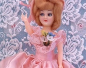 Antique Vintage 1950s Plastic Doll 71/2 inch tall Strawberry Blond Hair Bubblegum Cotton Candy Pink Dress with forget me nots Flowers