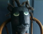 Grungy primitive black dollie headed to school