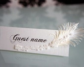 Ivory wedding place cards with feather & pearls