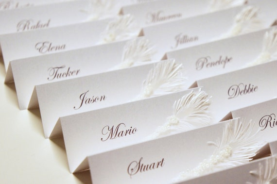 White Wedding place cards with pearls and feather decor | Luxury wedding table seating cards