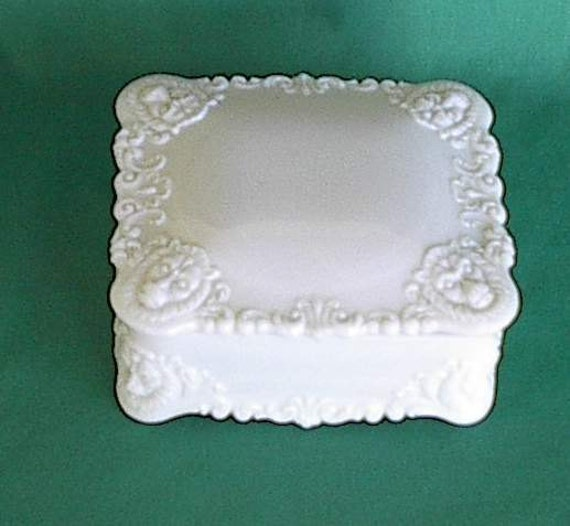 Antique milk glass trinket dresser box design of Lion's heads on all 4 corners of lid and box  Reserve for Irishiis