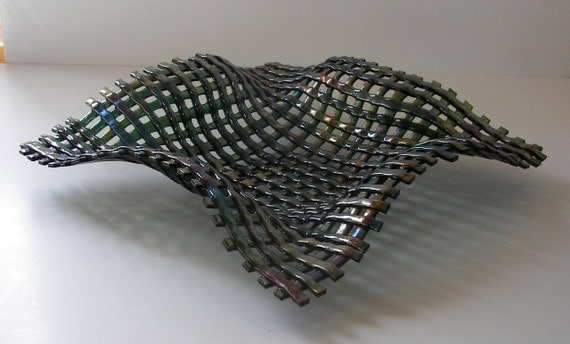WoVeN FuSeD GlAsS ArT DiSh in A GoRgEoUs OrGaNiC ShApE and ShiMmEriNg GrEEn IriDeScEnt GlAsS