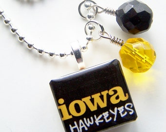 Iowa Hawkeye Scrabble Necklace and Two Glass Beads