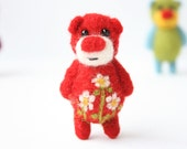 Bright red pocket bear with cammomiles