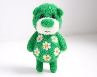 Deep green pocket bear sprinkled with daisies