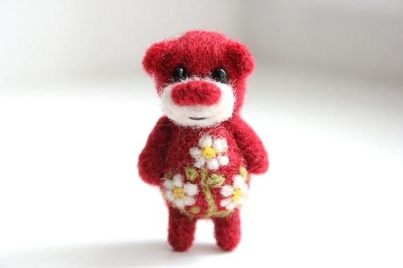 Miniature red felted summer bear