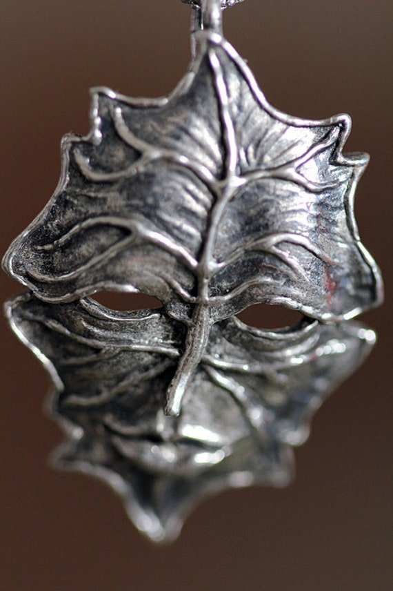 Greenman Pendant carved in NYC cast in Sterling silver or in white bronze.