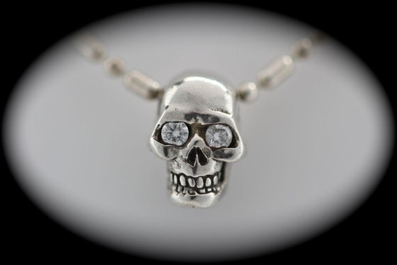 Tiny diamond eyed human skull pendant in sterling silver made in NYC Blue Bayer Design