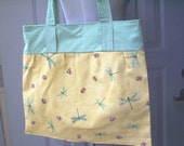 Dragonfly Print Purse with Ladybugs on Yellow Background with Green Accents.