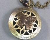 Zarina,Locket,Brass,Butterfly,Garnet,Red,Birthstone,Gemstone,Scent,Vintage. Handmade jewelery by valleygirldesigns.