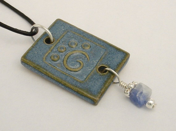 Dusk blue stylized paw print on rectangular pendant (JDB-P001b-1)